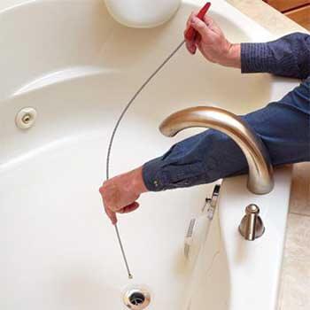 déboucher douche avec cable tarière